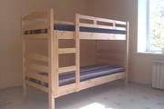 Кровать двухъярусная с матрасами.